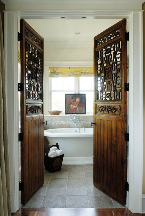 diggin the doors idea for the master bathroom when ever we build on.. ahh