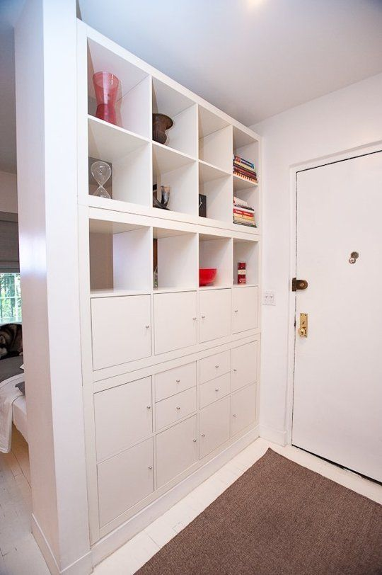 Jay used a series of stacked Expedit shelves (framed with millwork) to create a functional entryway with lots of storage.