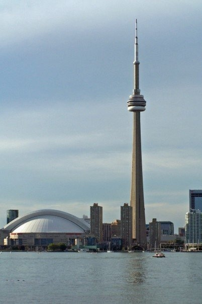 Toronto, Ontario, Canada - Dome on the left of CN Tower is the AirCanada Center where the Toronto Raptors (NBA) and the Toronto Maple Leafs (NHL) play!