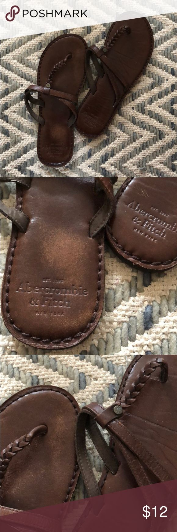 Abercrombie and Fitch leather sandals - brown Great condition. Thong sandal with strap. Beautiful rich brown. Leather is a little discolored on left foot as shown in photos. No one will notice while wearing tho! Super comfy I just never reach for these. Only worn maybe once or twice. I wear 61/2 and these fit me. I can't find the size but I think abercrombie sandals go by s,m,l. And I think these are a small. Abercrombie & Fitch Shoes Sandals