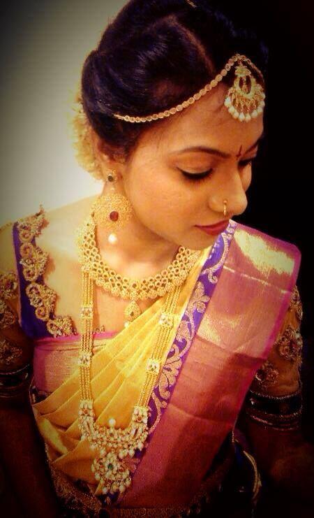 Traditional Southern Indian bride wearing bridal hair, saree and jewellery. Muhurat look. Makeup by Swank Studio. Find us at https://www.facebook.com/SwankStudioBangalore