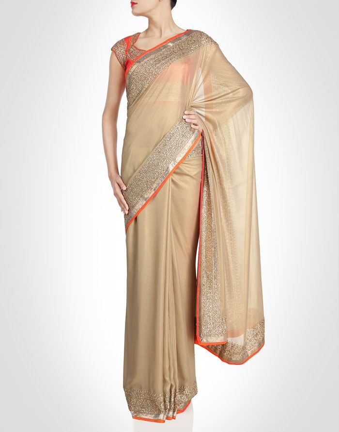 Gold toned sari bordered with kundan and gota. Shop Now: www.kimaya.in