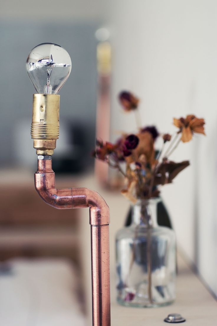 recycled copper lamps in the plus one berlin hotel room