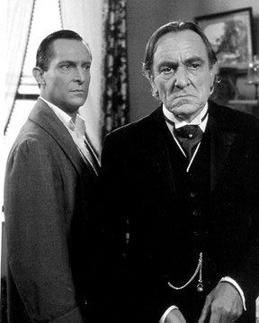 Jeremy Brett as Sherlock Holmes has a confrontation at Baker Street with Moriarty played by Eric Porter