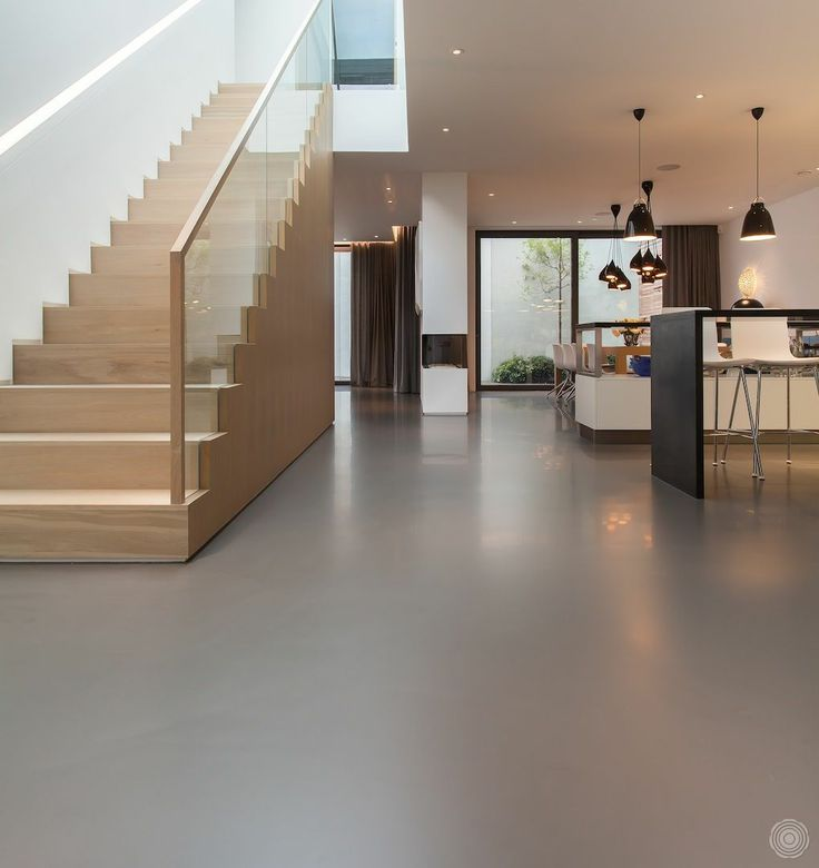 a derelict site transformed into a beautiful city home; nice staircase and continuous floor