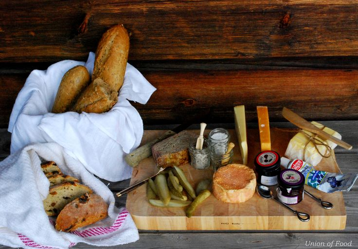 Cabin. Tiny cheese conserves, pickels, and paté on a board. Serving idea. Glamping.
