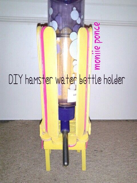 A popsicle water bottle holder I made for my hamsters bin cage, tutorial on youtube search moniie ponce and click my channel or search 'DIY Hamster Bottle Holder from Popsicle Sticks'