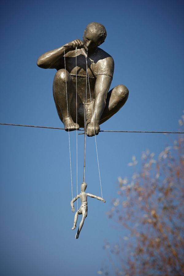 Cold cast bronze, aluminium Garden Or Yard sculpture by artist Jerzy Kedziora titled: 'The Puppeteer (Bronze resin High Wire figurative statues)' £16,667