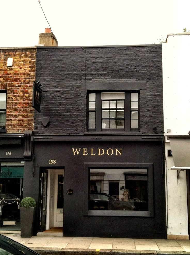 For the store....paint it black. classic with gold letters Chelsea, London