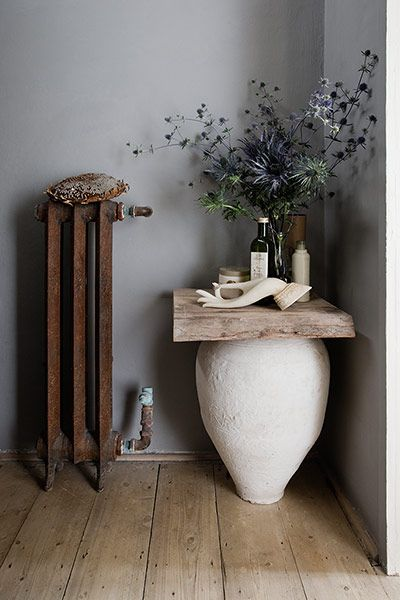 Credit: Richard Boll Be unconventional A bathroom doesn't have to look like a bathroom. I found this lovely Turkish urn at Brighton market and painted it cream. The piece of weathered timber is from a local wood recycling yard, and the radiator is from Ardingly Antiques Fair, near Gatwick airport.