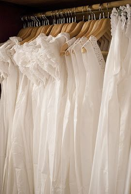 white and soft in the closet. . .nightgowns on wooden hangers