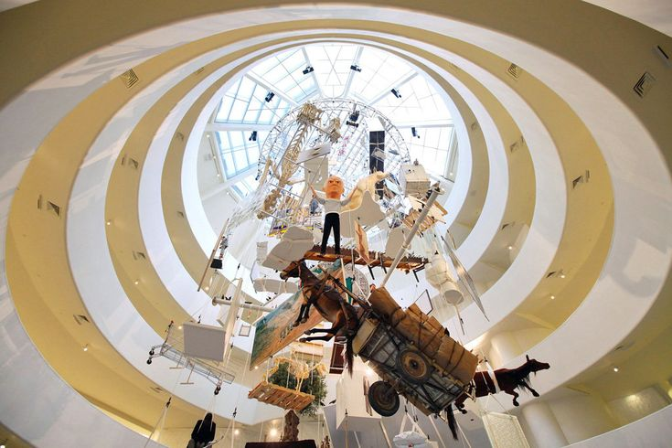 The Maurizio Cattelan retrospective at the Guggenheim contains an eye-catching arrangement of 128 works.