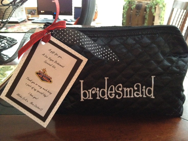 DIY Bridemaids gifts for a Vegas wedding. Cosmetic embroidered bag from Michael's (cheap!) filled with small mirror, tissues, cotton balls, qtips, bandaids, nail file, dental floss, disposable toothbrush, gum, etc...handmade card tied on with ribbon and bow!