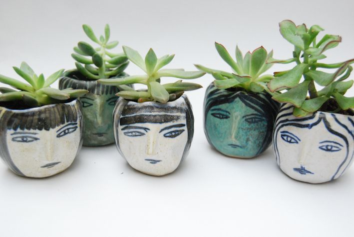 Ceramic girl planters. Made by Kaye Blegvad.