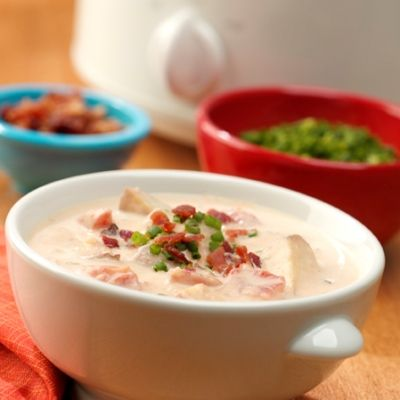 Creamy potato soup with chunks of red-skinned potatoes and spicy tomatoes with green chilies