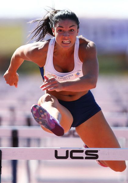 Michelle Jenneke Photos Photos - Michelle Jenneke of NSW competes in the womens 100 metre hurdle during the 2015 Canberra Track Classic on February 7, 2015 in Canberra, Australia. - Canberra Track Classic