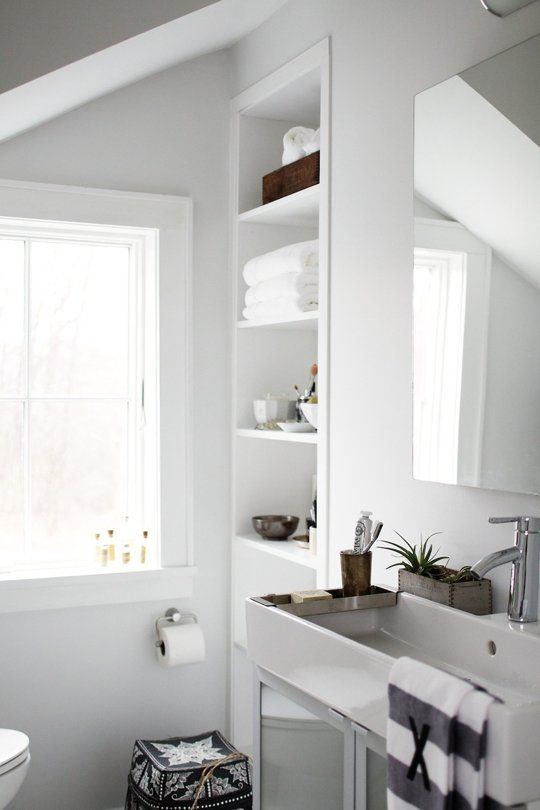 I love the open shelving in the bathroom. Makes it feel larger with the open design.
