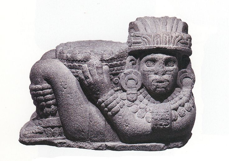 Chacmool-1943  Excavated in 1943 at the corner of Venustiano Carranza and Pino Suarez   Streets, Mexico City. Wears a Tlaloc mask and a pendant with an        archaistic motif.