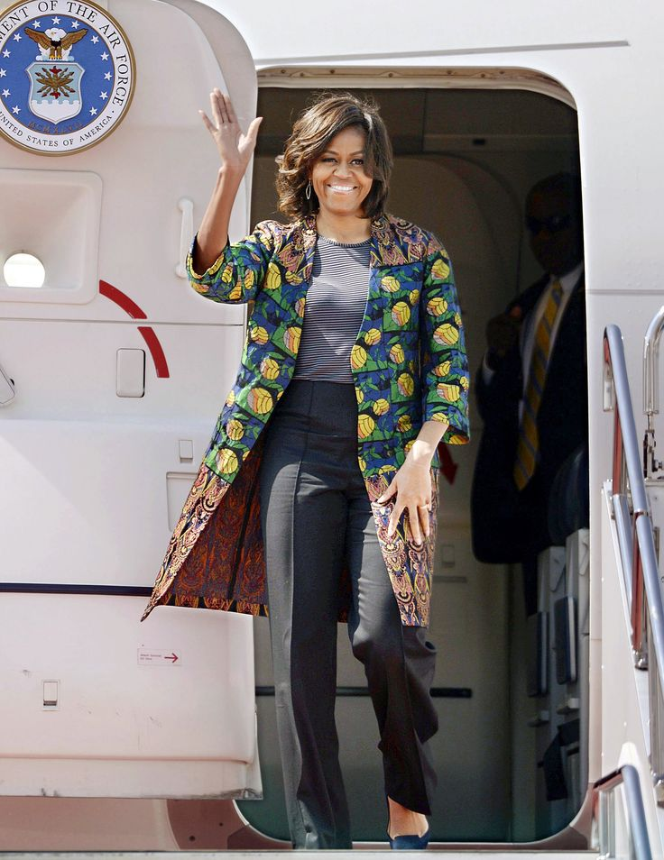 """""""A stylized leaf print Dries Van Noten coat over a striped T-shirt and black pants."""" I love the prints and colors she wears, but I think lot of Michelle Obama's choices aren't really flattering for petite frames like me. I would wear this though."""