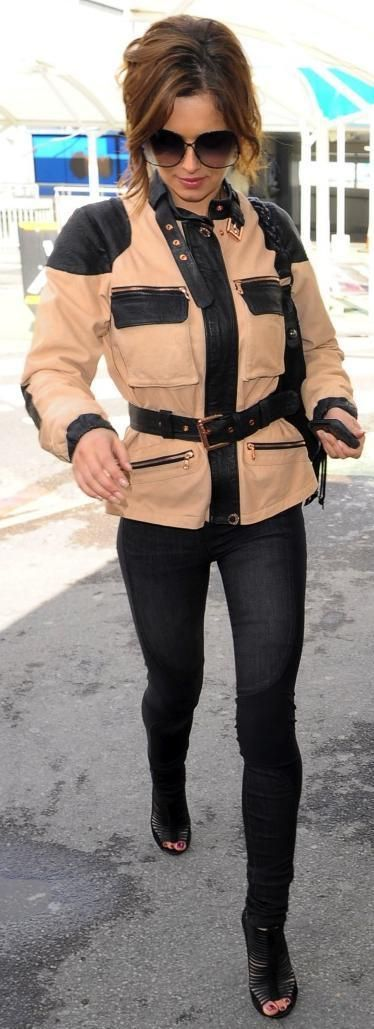 Who made Cheryl Cole's sunglasses, fringe purse, pink and black jacket, black shoes and skinny jeans that she wore at Heathrow airport? Jeans – Helmut Lang  Jacket – Belstaff  Sunglasses – Victoria Beckham  Purse – Mulberry  Shoes – Nicholas Kirkwood