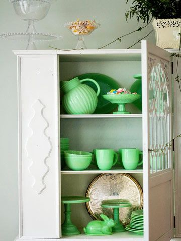 So pretty to have a collection of green milk glass, or any colored dishes, in a white cupboard.