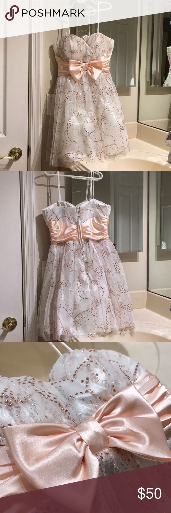 Camille La Vie white and copper dress Only worn once. Has copper and silver dots of glitter with a big peach bow in the center. Has a heart cut front. About 31 inches long from straps to bottom. Camille La Vie Dresses Formal