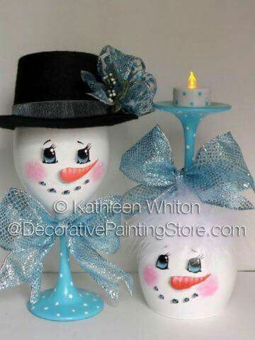 Snowman painted wine glass candle holders.