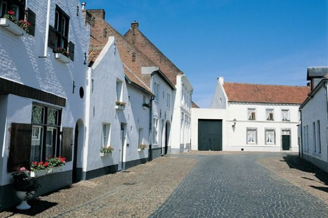 (Visit Holland) Ten Secret European Villages: Thorn, Holland (The white village of Thorn in Holland boasts pretty cobbled streets, the beautiful Abbey Church and cute whitewashed houses. Dating back to the late 10th century, Thorn became a 'white village' when the French arrived and claimed a tax based on the size of the windows. The poor population living in large houses formerly owned by aristocrats could not afford this, so they bricked up the windows and tried to cover up their…