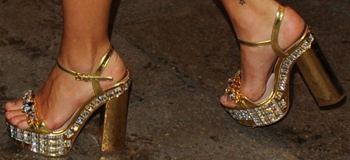Image from http://cdn.yournextshoes.com/wp-content/uploads/2013/09/jeweled-platform-sandals.jpg.