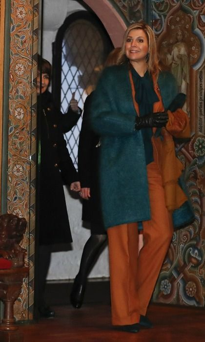 A quick trip to the Wartburg Castle didn't halt Maxima's style. The Queen wore a rust colored pants ensemble topped with a teal overcoat.