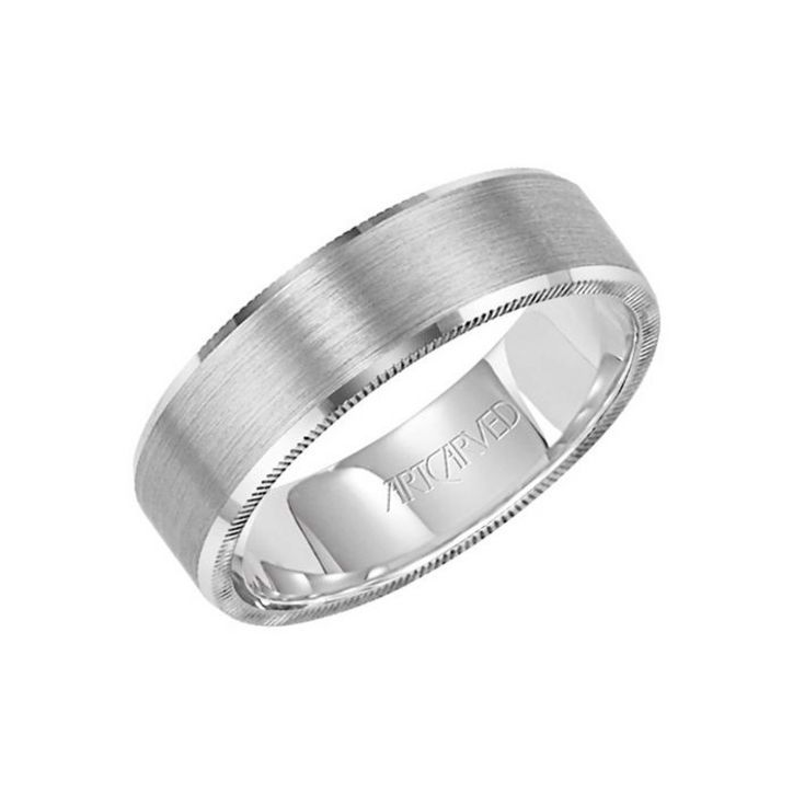 This simple men's wedding band features a brushed gold finish accented by