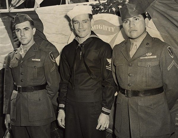 Survivors of Iwo Jima flag raising at unveiling of statue in New York, May 11, 1945. Joe Rosenthal's iconic photograph made them celebrities at the War Bond rallies. L-R Rene Gagnon, John H. Bradley, and Ira H. Hayes.