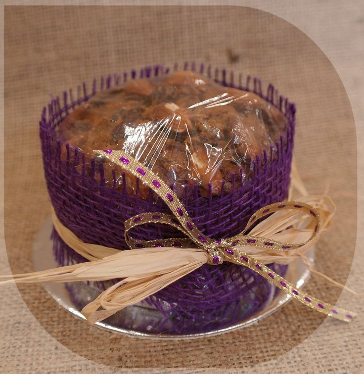 The purple wrapped Christmas cake - tied on with natural raffia and a touch of blingy ribbon.