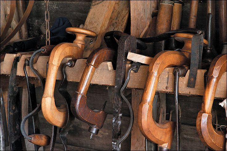 With curved drawknives to shape wooden staves and bitstocks to drill holes for pins, the cooper fashioned casks and barrels.