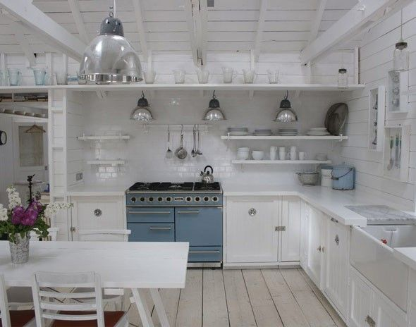 white kitchen, range cooker, metal pendant lights, Cottage in Camber, Sussex, UK, designed by Dave Coote.