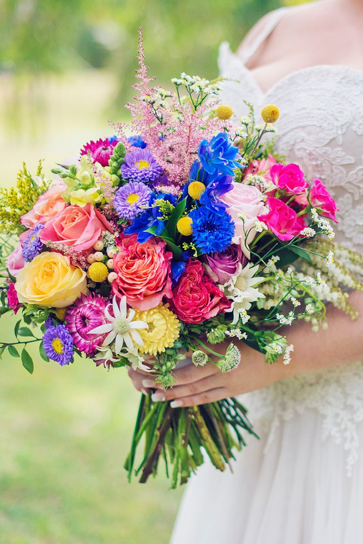 a royal blue country wedding with colourful blooms