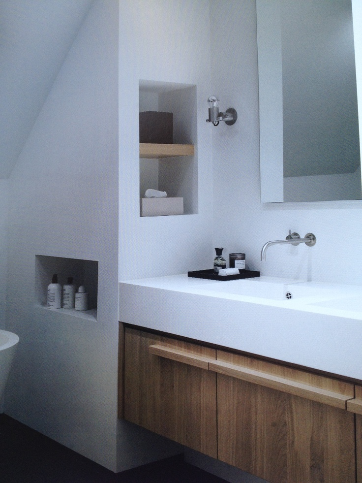 "square sink with storage drawers in wood, ""storage"" space/counter next to sink."
