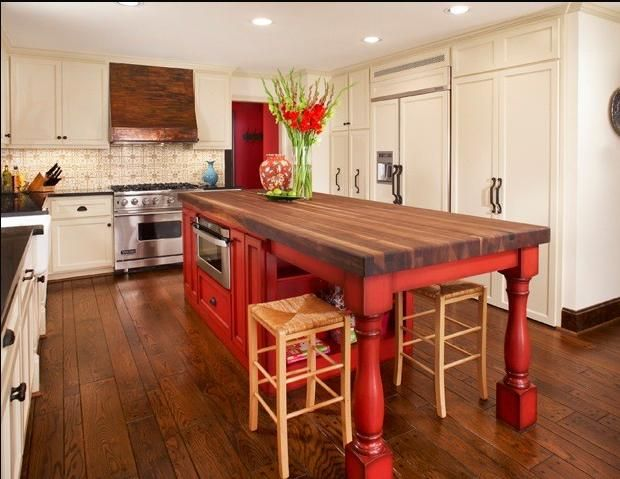 I like this rustic kitchen island, although I'd prefer a lighter wood, not red