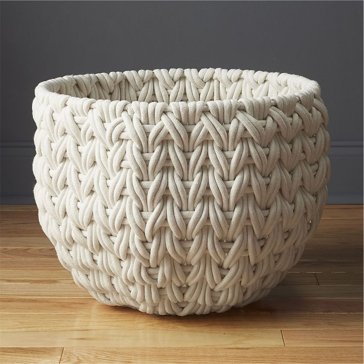 "Shop conway baskets. Super-chunky cotton rope weaves textural containers perfect for stashing all the stuff you don't want to see. Sturdy iron frames disappear under an extra-nubby, extra-tight, inverted ""V"" weave."