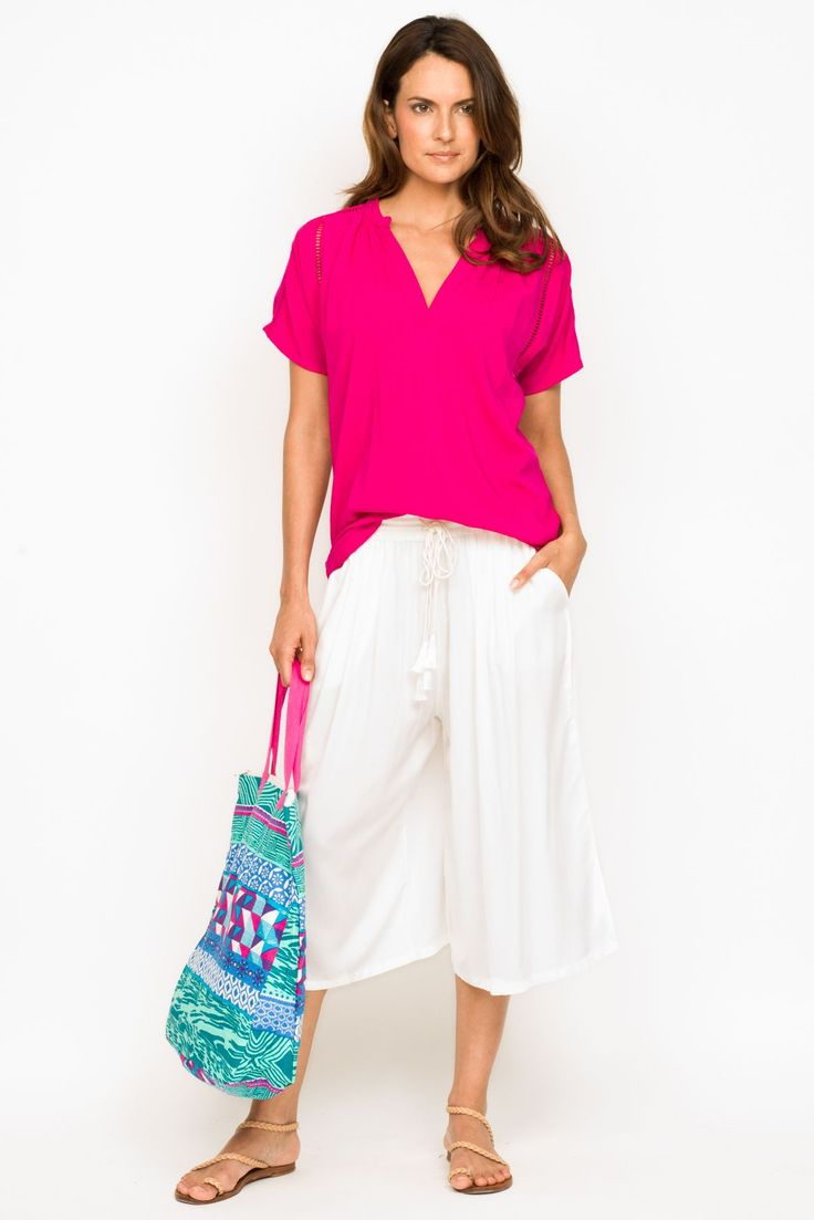 Add some POP to your wardrobe with the Summer Top in Pink, this beautiful, easy fit top is sure to become a favorite!