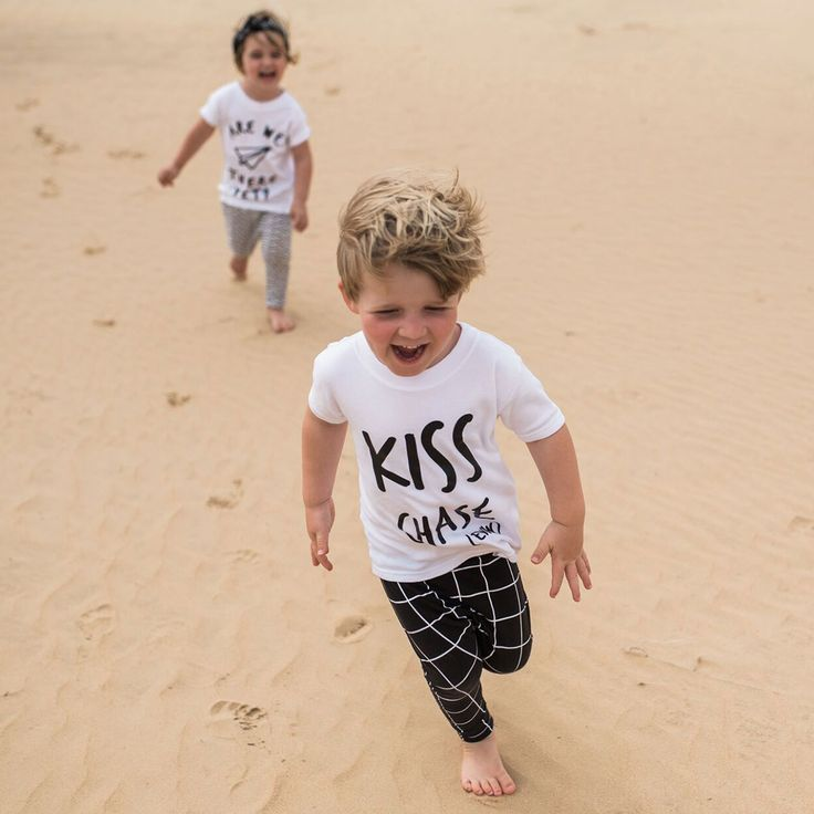 Kiss Chase (Eww) T-Shirt | Do you remember playing Kiss Chase at school? Well we've brought this classic childhood game out of the playground and into the world of fashion, so that your little romantics can look cool whilst they break hearts. Made in the UK from 100% cotton, this classic short sleeved t-shirt comes in white with our own designed 'Kiss Chase (Eww)' slogan hand printed on the front. Added authenticity comes from the original Kidult and Co tag hand stitched on the front at the…