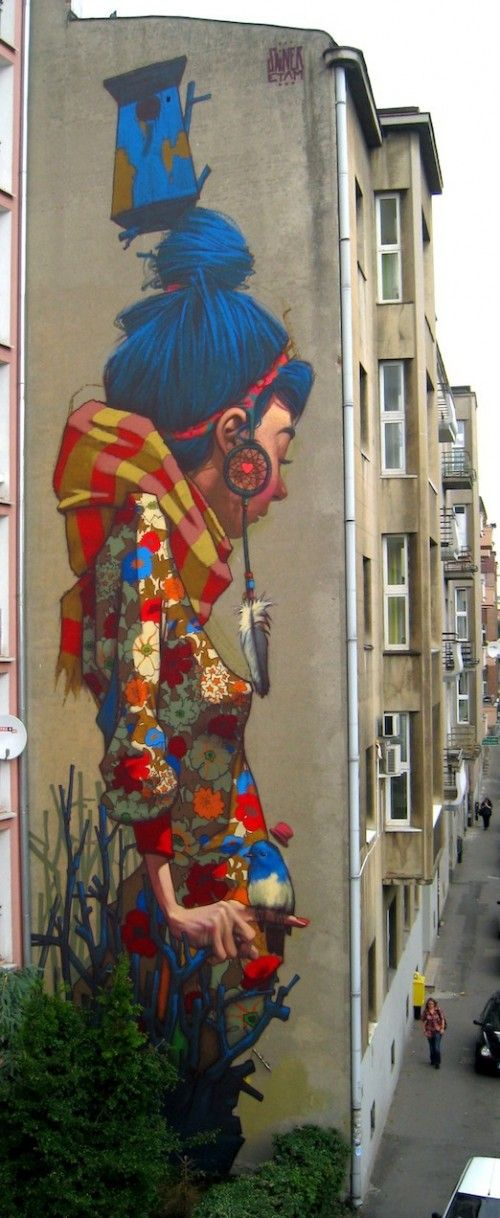 Colorful street art in Lodz, Poland created by street artist Sainer. The location info came courtesy of the HomeRefiner... thanks much...