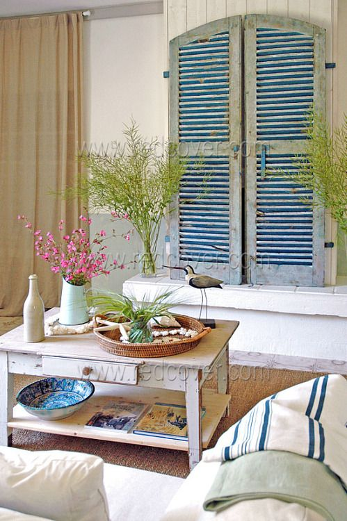 TV behind the shutters (and a way to fill a wall and suggest a window- maybe for master bath wall?)  Beach Cottage Chic Living
