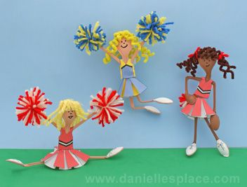 Cheerleader Craft Made with plastic spoons, and paper outfits