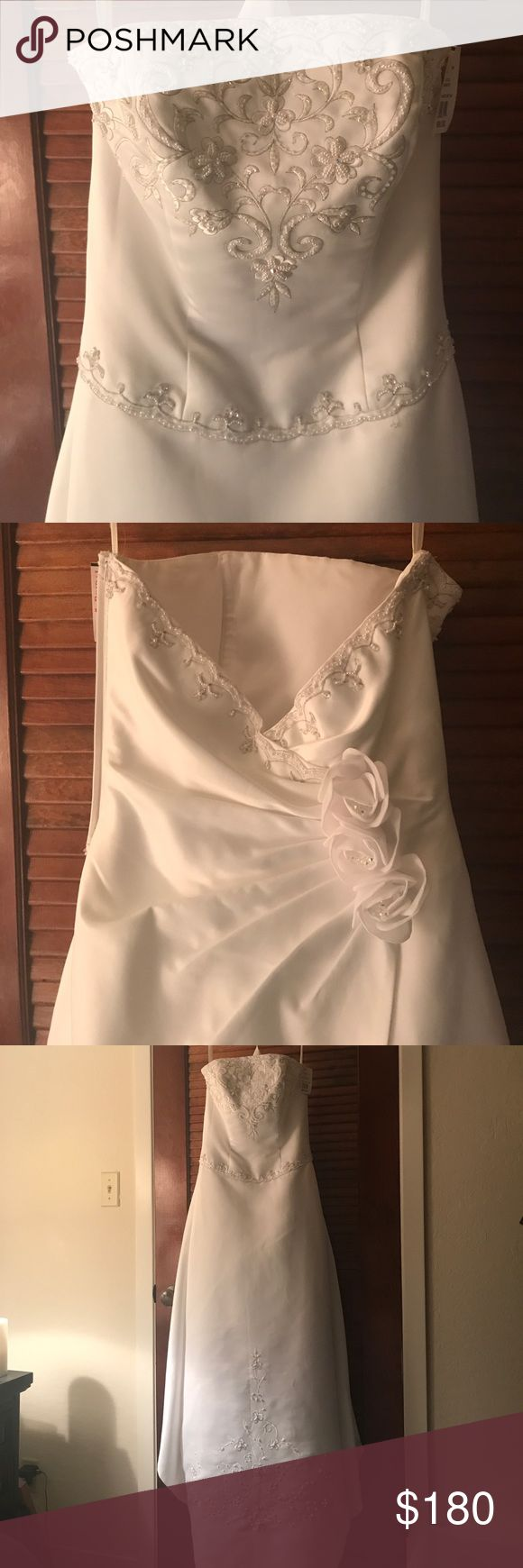 NWT white strapless wedding dress with roses beads New with tag, never worn, kept in the garment bag that came with the purchase. Strapless. Beaded. Long bustle. David's bridal collection. David's Bridal Dresses Wedding