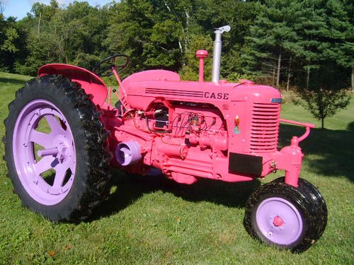 Antique pink tractor... who do you think planted and harvested while half the nation's men were at war?