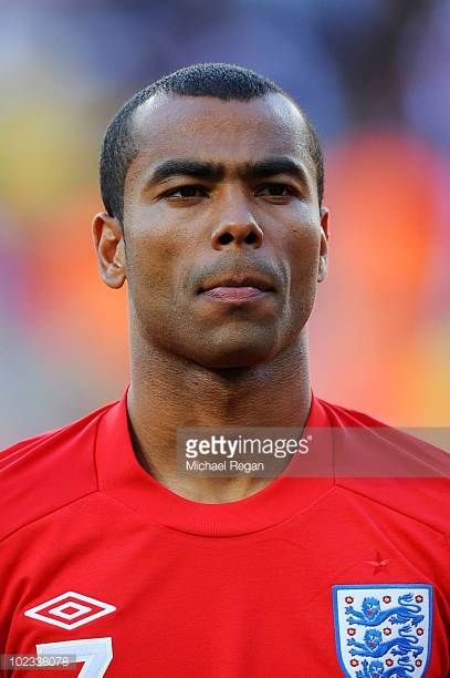 Ashley Cole lines up for the national anthems prior to the 2010 FIFA World Cup South Africa Group C match between Slovenia and England at the Nelson...
