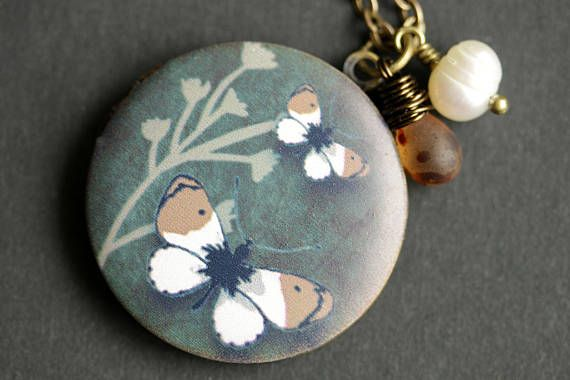 Gray and Brown Moth Locket Necklace. Moth Necklace with Mottled Brown Teardrop and Fresh Water Pearl Charm. Gray Necklace. Bronze Locket. by TheTeardropShop from The Teardrop Shop. Find it now at http://ift.tt/2uEdCpo!