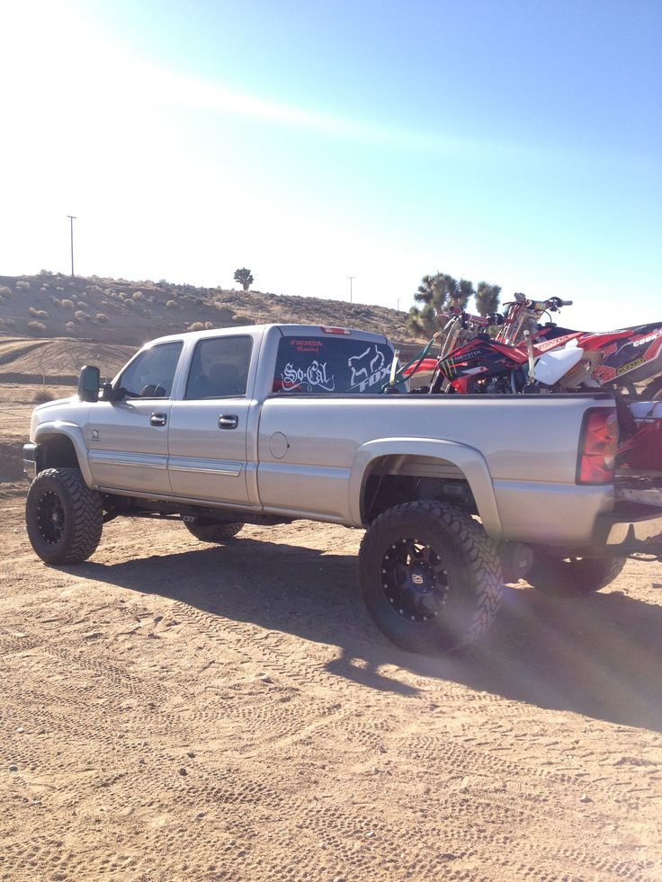 day at the track lifted truck with our dirtbikes in the back. Black Bedroom Furniture Sets. Home Design Ideas