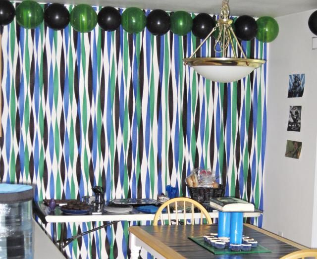 HALO party I don't fully understand it, but that black and green balloon border would be really easy to put up somewhere